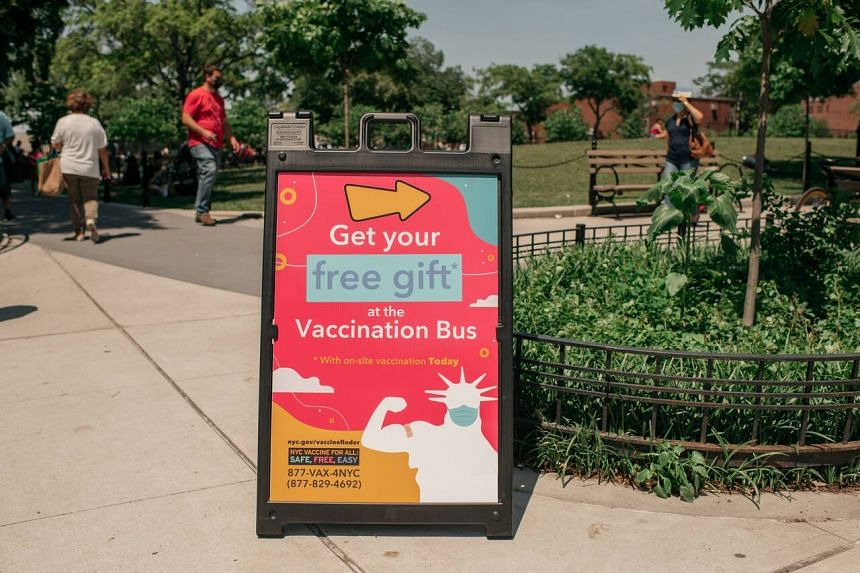 A sign encourages passers-by to attend a pop-up Covid-19 vaccine site and block party in New York City on June 5, 2021.