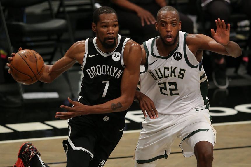 Kevin Durant (left) and Khris Middleton at the 2021 NBA Playoffs at Barclays Center, in Brooklyn, New York, on June 5, 2021.