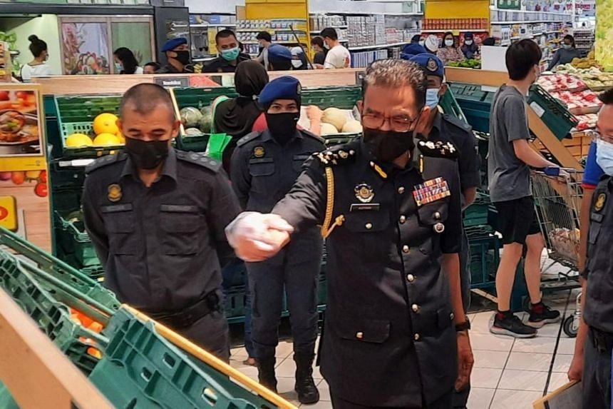 Domestic Trade and Consumer Affairs Ministry enforcement director Azman Adam at a supermarket in Penang on April 18, 2021.