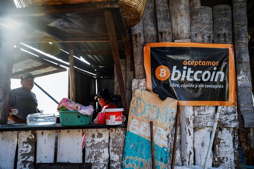 """A banner that reads """"We accept Bitcoin, free, fast and without contagion"""" at a cafe on Punta Roca Beach in El Salvador."""