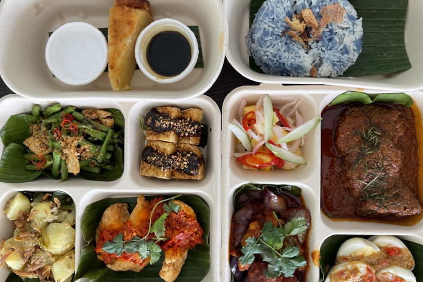 Each bento comprises rice and three dishes comprising a main, tahu goreng and a vegetable.