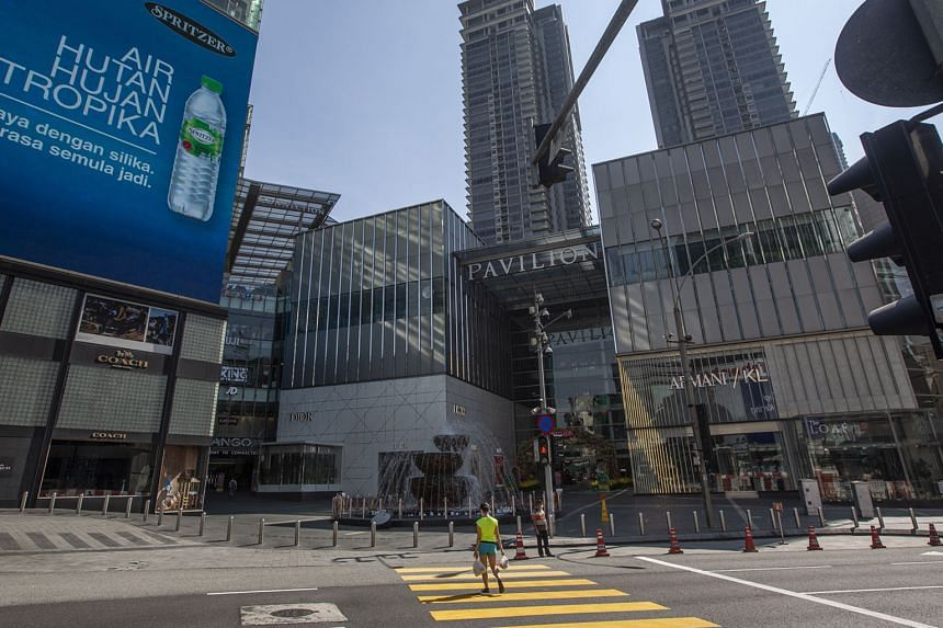 A near-empty street in the business district of Bukit Bintang in Kuala Lumpur last Thursday, two days after Malaysia's latest lockdown began. There is anger, however, among Malaysians over the number of businesses still operating despite tightened re