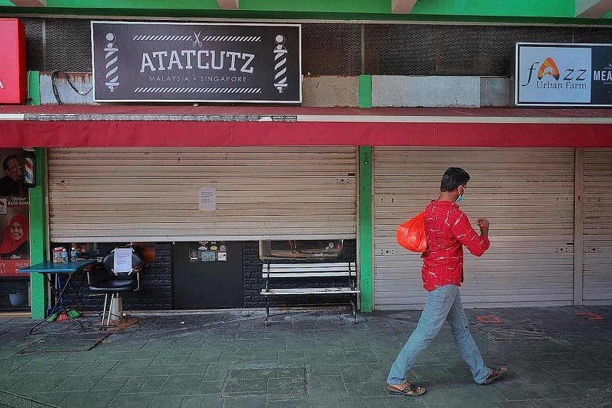 Atatcutz Singapore in Bedok yesterday. A new Covid-19 cluster at the barber shop had six cases as at Saturday. Three of the infected barbers are Malaysians aged 24 to 27. Two of them live in the same household with a 46-year-old Singaporean woman who