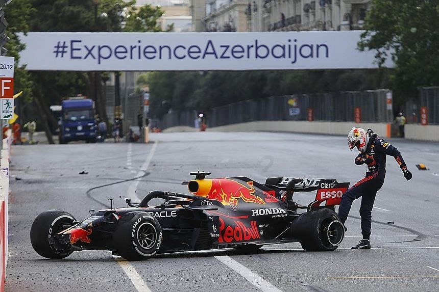 Red Bull's Max Verstappen kicking the wheel of his car after crashing out of the Azerbaijan Grand Prix while leading yesterday. A tyre puncture ended his run of top-two finishes this year but he kept his championship lead.