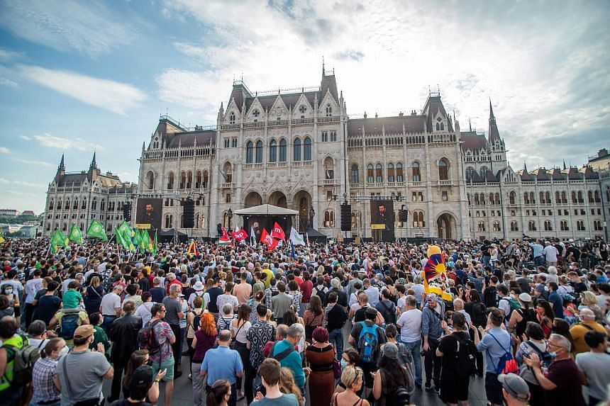 People protesting outside Parliament in Budapest last Saturday. They say the Fudan University project reflects the PM's disregard for democratic values. PHOTO: EPA-EFE