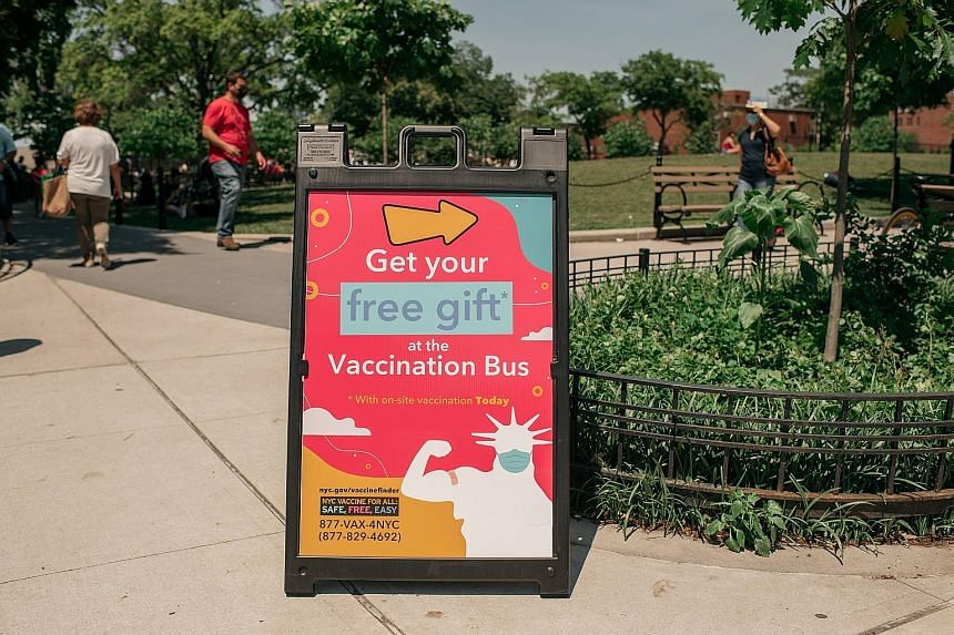 A sign encouraging passers-by to attend a pop-up Covid-19 vaccination site and block party, in the Queens borough in New York City, on Saturday.