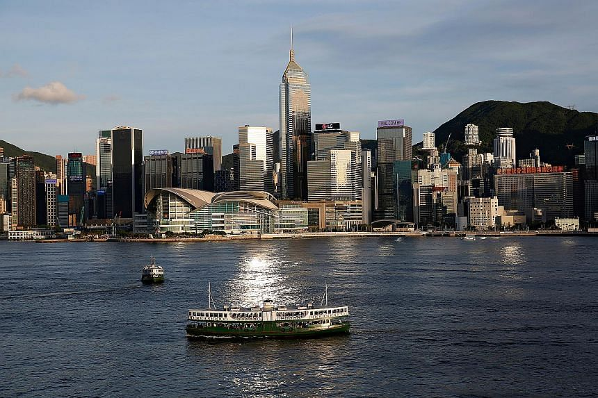 A boat crosses Victoria Harbour in Hong Kong on June 29, 2020.