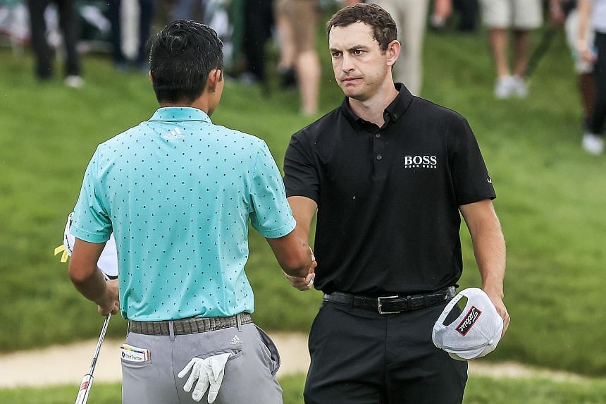 Patrick Cantlay (right) shakes hands with Collin Morikawa in Ohio, US, on June 6, 2021.