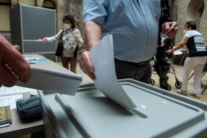 A voter casts his ballot at a polling station in Magdeburg's Art History museum, on June 6, 2021,