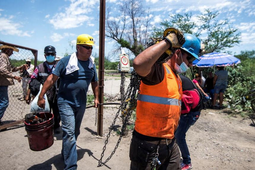 Rescuers and colleagues of trapped miners carry out rescue work in Coahuila state, Mexico, on June 6, 2021.