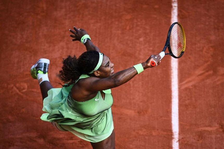 Serena Williams returns the ball to Kazakhstan's Elena Rybakina during their fourth round tennis match in Paris, on June 6, 2021.