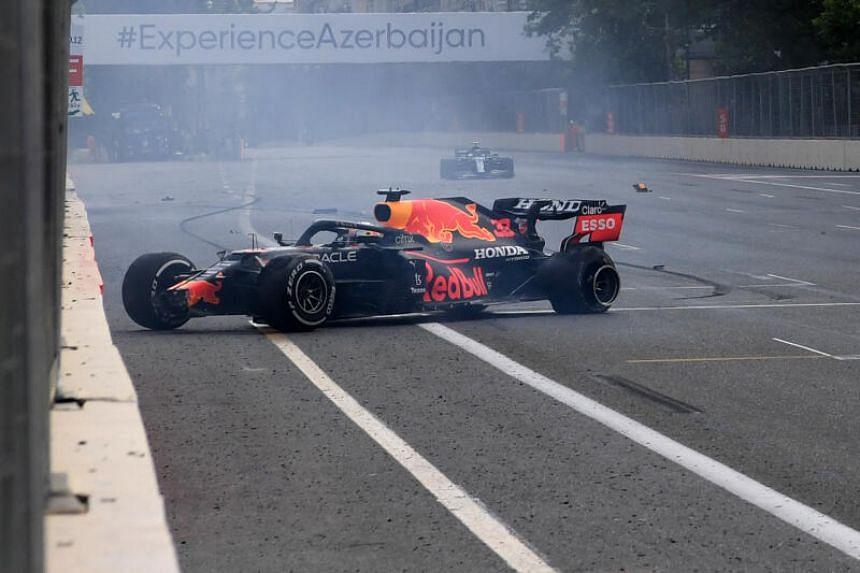 Red Bull's Dutch driver Max Verstappen crashes during the Formula One Azerbaijan Grand Prix in Baku, on June 6, 2021.