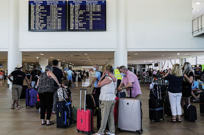 British tourists and residents queue to return to England at Faro airport in the Algarve on June 6, 2021.