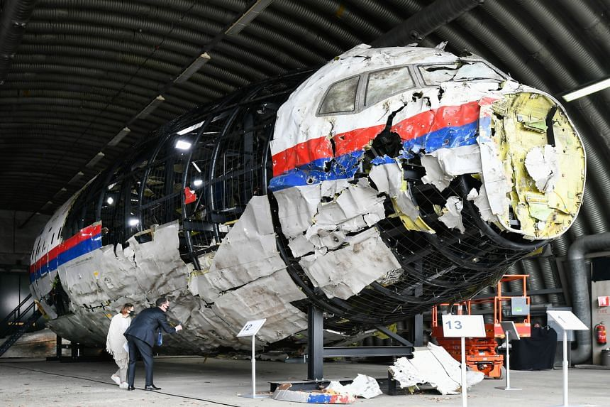 Lawyers attend the judges' inspection of the reconstruction of the MH17 wreckage in Reijen, the Netherlands, on May 26, 2021.