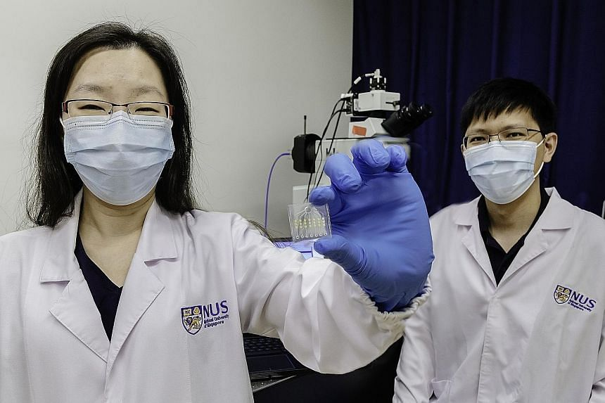 Assistant Professor Shao Huilin, holding an ExoScope sensor, and Dr Sijun Pan are part of a team from the National University of Singapore that developed ExoScope, a blood test which is able to detect cancer drug effectiveness within a day.