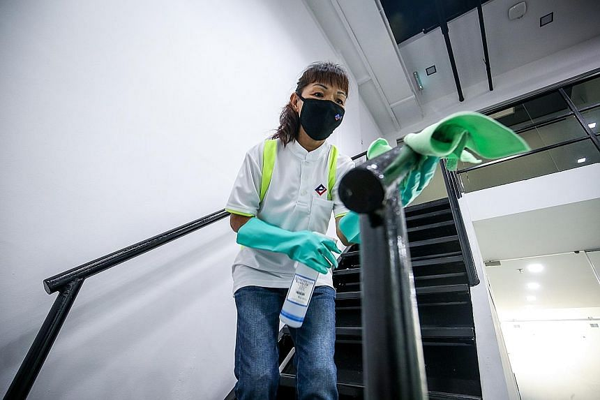 Ms Chia Mui Noi, 61, a general cleaner who joined LS 2 Services last year, leads the cleaning team at a junior college. Ms Chia said she was very happy to hear about the wage increments.