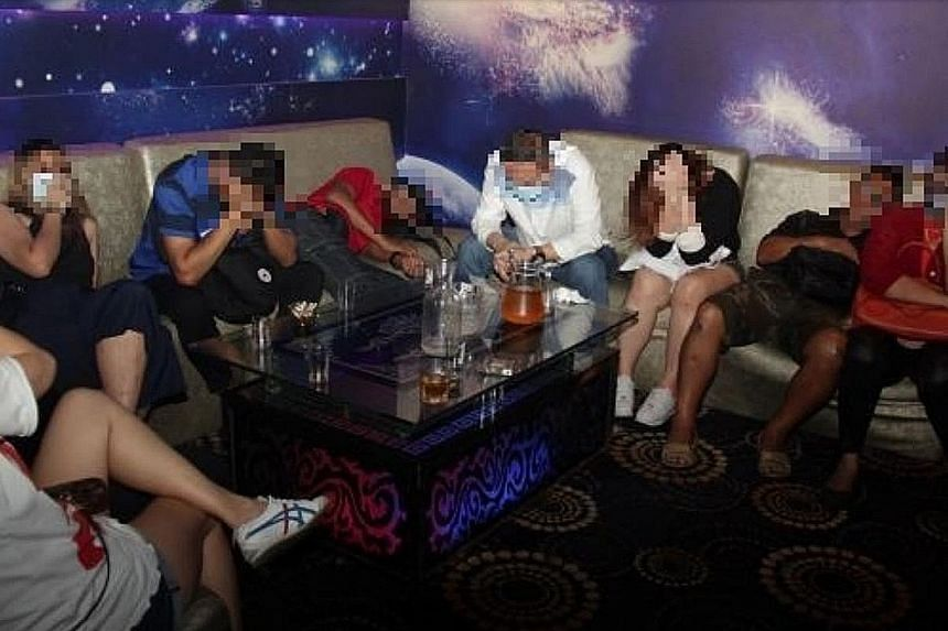 A total of 26 men and seven women, aged between 20 and 68, were found by the police in the unlicensed karaoke outlet in Tanjong Pagar. The police said karaoke equipment, liquor bottles and cans of beer found in the unit were also seized as part of th