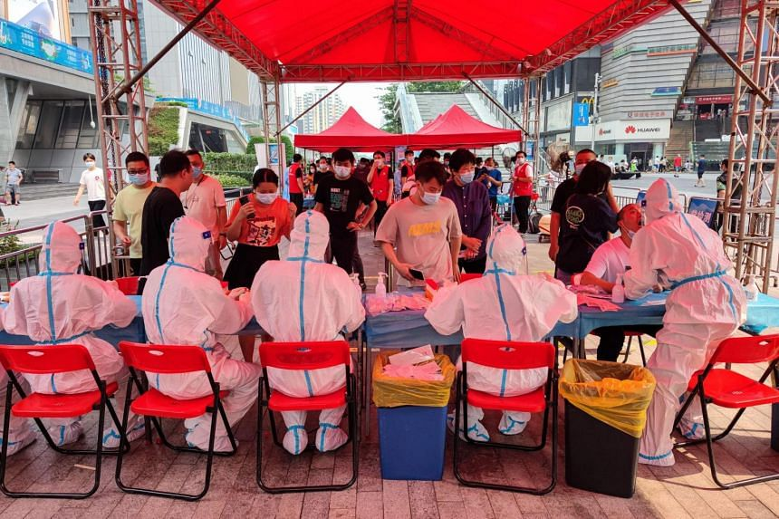 People queueing to receive nucleic acid tests for Covid-19 in Shenzhen, Guangdong province, on June 6, 2021.