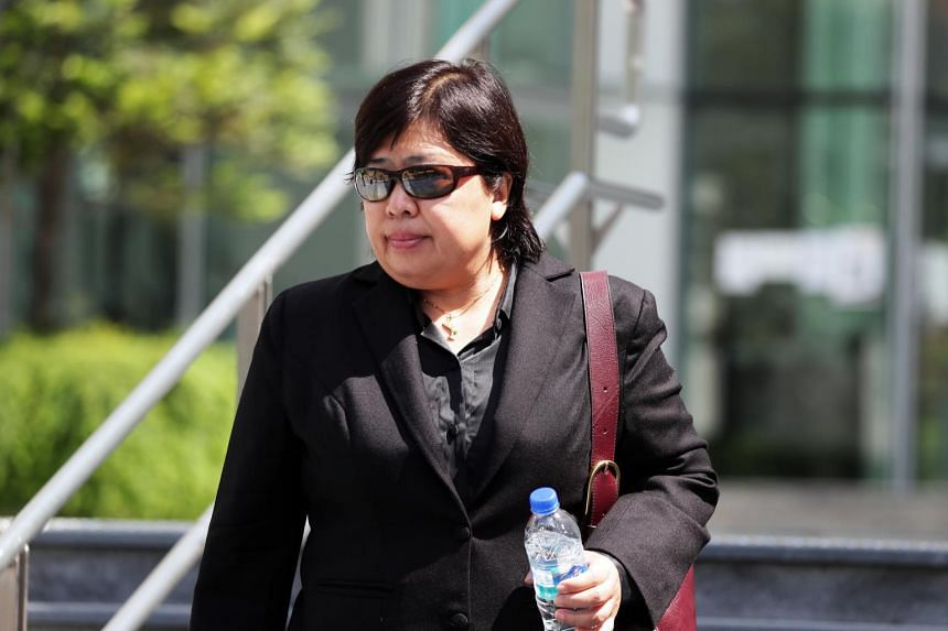 Phoon Chiu Yoke leaving the State Courts on May 24. She has been released on $8,000 bail.