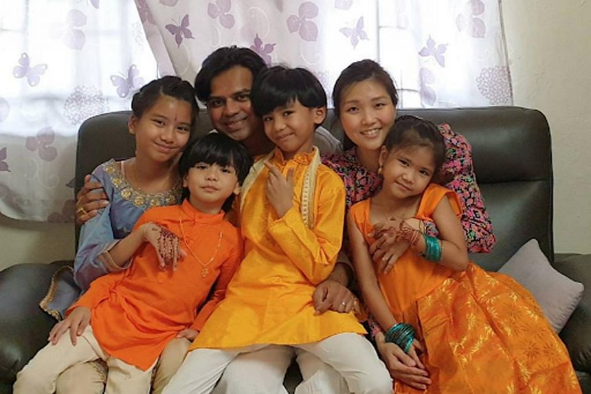 Mr Devarajan D. Krishnan and his wife Lim Lee Samantha, with their four children (from left) Hailey, Zachary, Riley and Zoey.