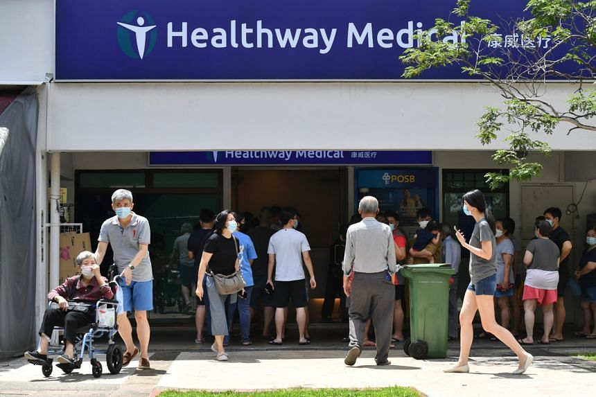 People queueing up for swab tests at a Healthway Medical Clinic after a Covid-19 cluster was confirmed at a Foodfare coffee shop in Anchorvale, on May 31, 2021.