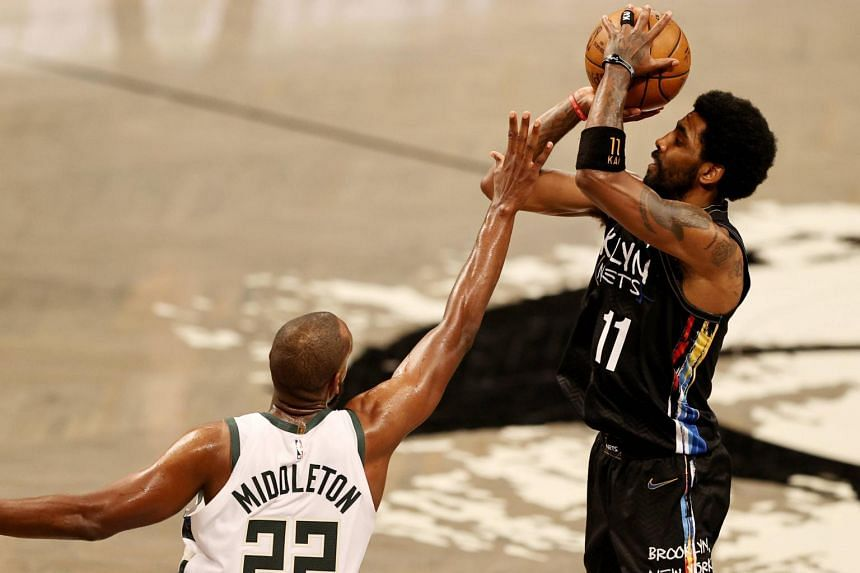 Kyrie Irving takes a shot at Barclays Center, in Brooklyn, New York, on June 7, 2021.