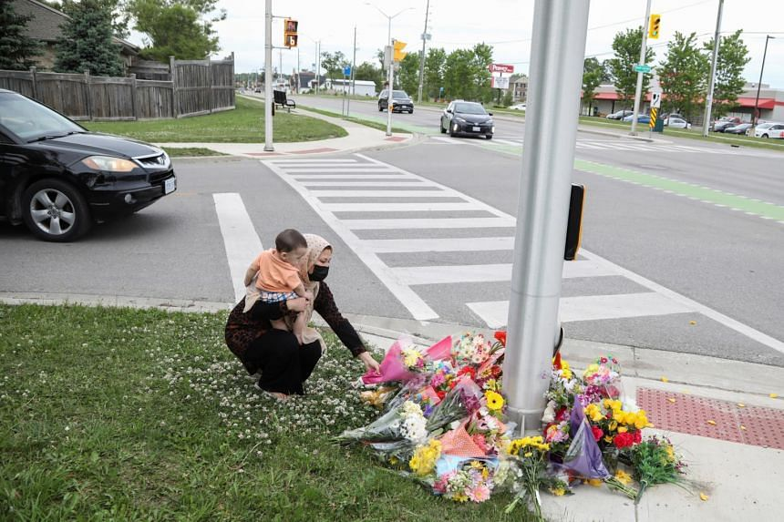 Ms Nafisa Azima laying flowers at the fatal crime scene in London, Ontario in Canada on June 7, 2021.