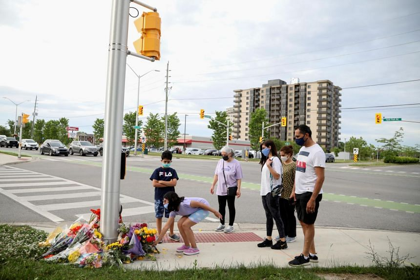 Members of the Selamati lay flowers at the fatal crime scene in London, Ontario in Canada on June 7, 2021.