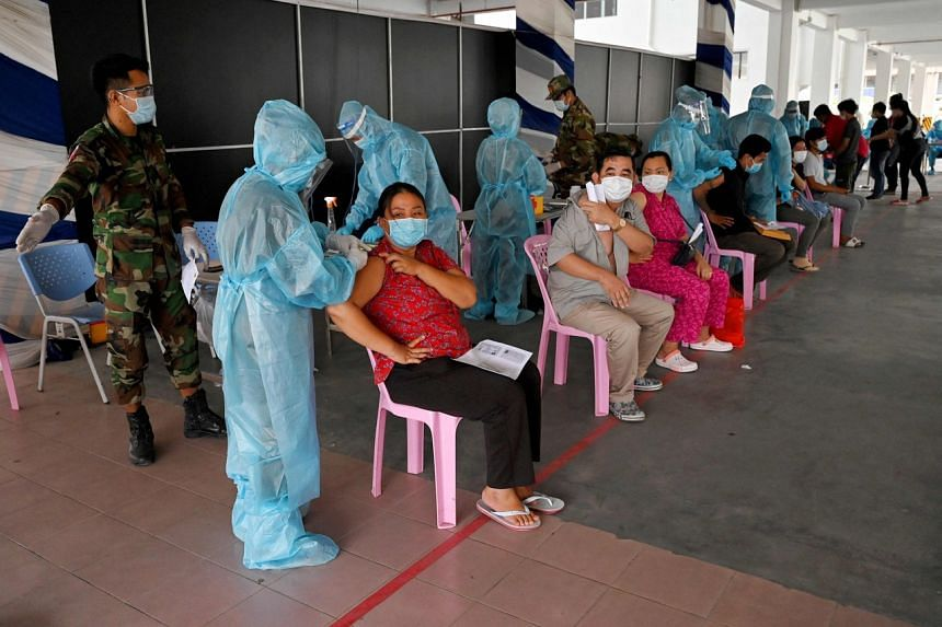 People receive the Sinovac vaccine in Phnom Penh on May 1, 2021.