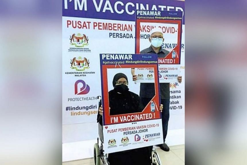 Ms Azmah Hairun (left) urged those who had yet to be registered for the vaccine to immediately do so.