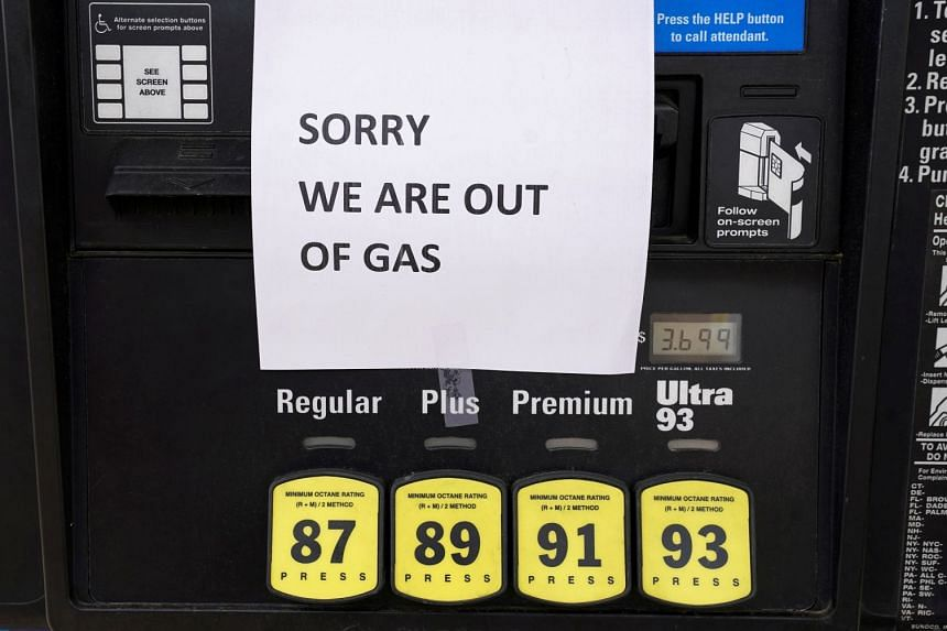 A sign tells drivers that fuel pumps are empty as people panic-buy, following the hacking attack on the Colonial Pipeline.