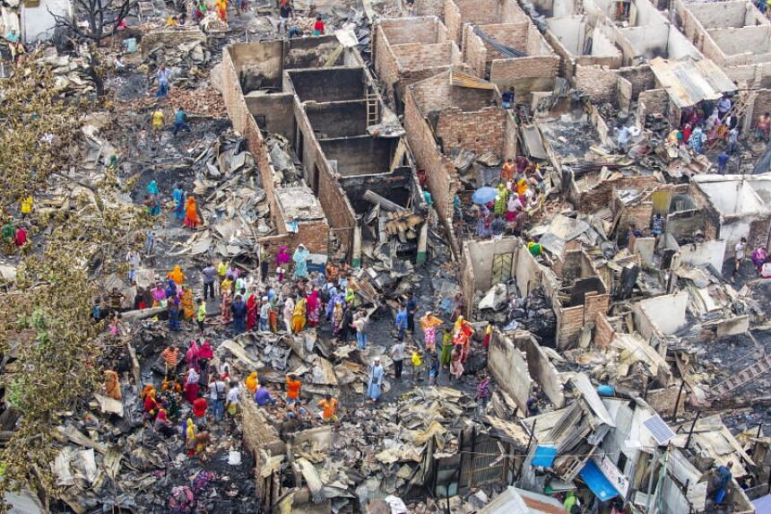 The aftermath of a fire at the Sattola slum in Mohakhali area in Dhaka, Bangladesh, on June 7 2021.