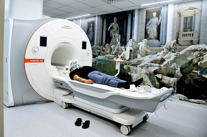 A man undergoes a magnetic resonance imaging (MRI) scan in Rome in April 2021..