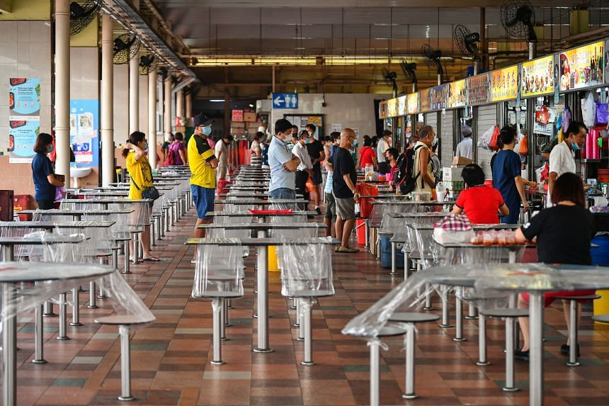People observing social distancing while queueing at Chong Boon Market and Food Centre yesterday. Nine new Covid-19 cases, including three in the community, were confirmed yesterday. This is the lowest daily number of Covid-19 cases in Singapore sinc