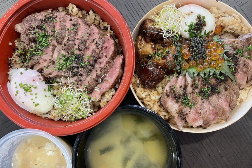 The Fat Cow Donburi comes with seasoned rice topped with thick slices of charcoal-grilled wagyu, an onsen egg and alfalfa sprouts.