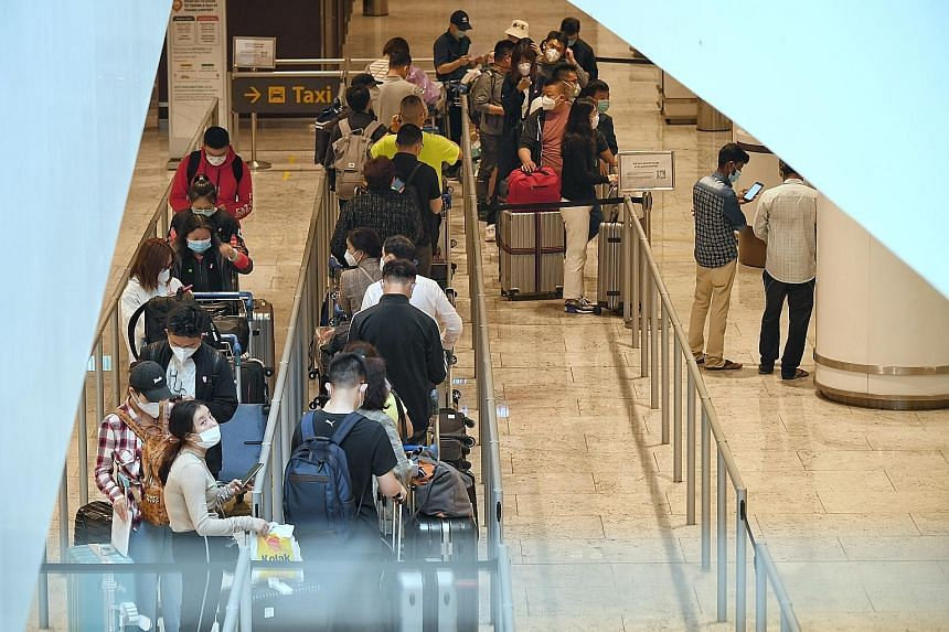 Passengers queueing for taxis at Changi Airport's Terminal 1 on April 30. The Delta variant surfaced in the two biggest community clusters here in recent months - in Changi Airport and Tan Tock Seng Hospital.
