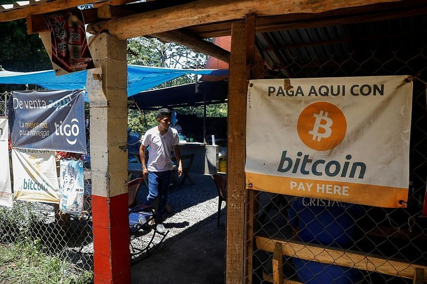 A Bitcoin banner at a eatery in Chiltiupan, El Salvador. While many regulators have criticised the growth of cryptocurrencies, their transparent transactions can work against lawbreakers.