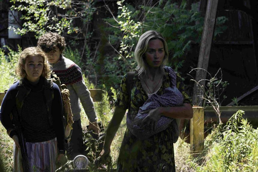 A Quiet Place Part II starring Emily Blunt (far right), Millicent Simmonds (left), and Noah Jupe (centre).