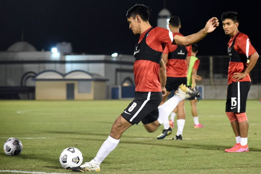 Shahdan Sulaiman practices his free-kicks as the Singapore national team train ahead of their final World Cup qualifying match against Saudi Arabia.
