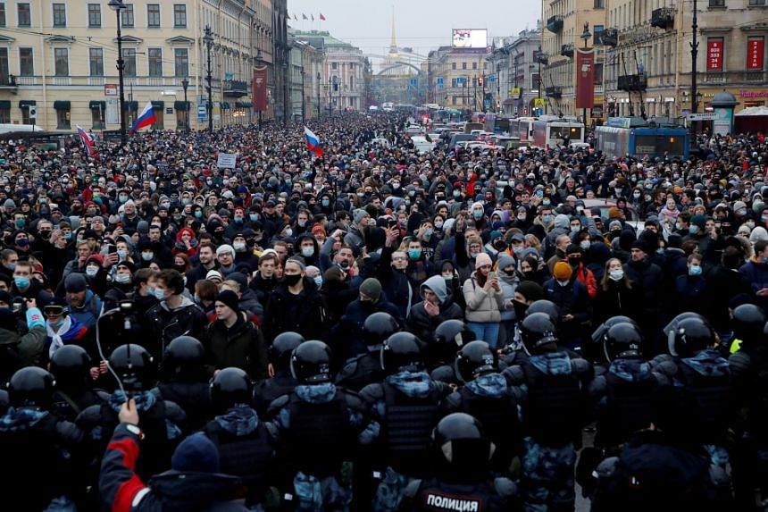 In this photo taken on Jan 23, 2021, law enforcement officers stand in front of participants during a rally in support of jailed Russian opposition leader Alexei Navalny in Saint Petersburg.