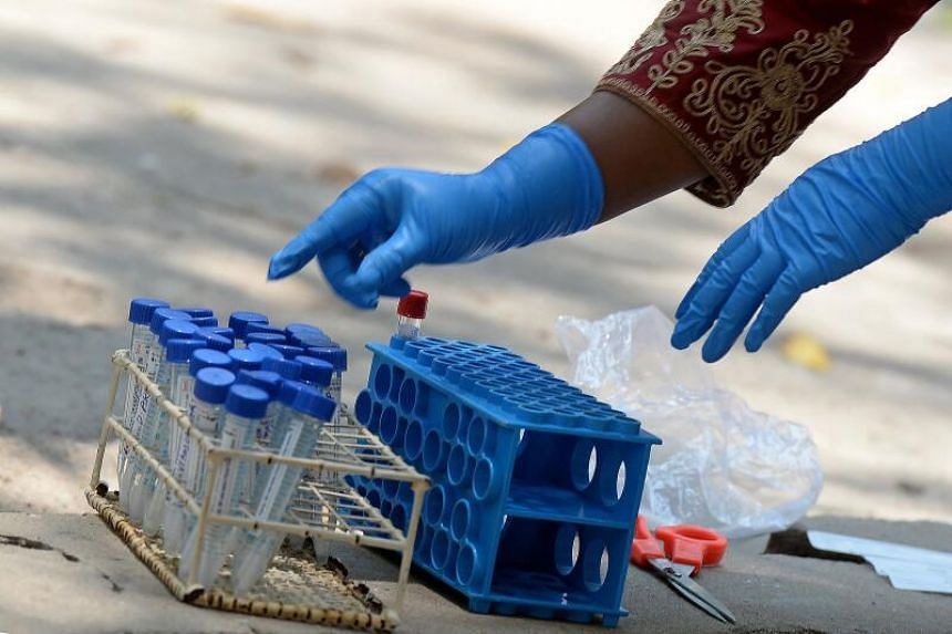 A medical worker arranges swab samples from the Reverse Transcription Polymerase Chain Reaction (RT-PCR) tests conducted for the Covid-19 coronavirus screening at a testing centre in Hyderabad on April 29, 2021