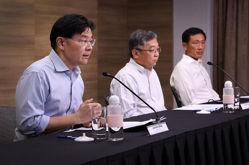 (From left) Ministers Lawrence Wong, Gan Kim Yong and Ong Ye Kung respond to a question on how the pandemic may have contributed to recent racist incidents.
