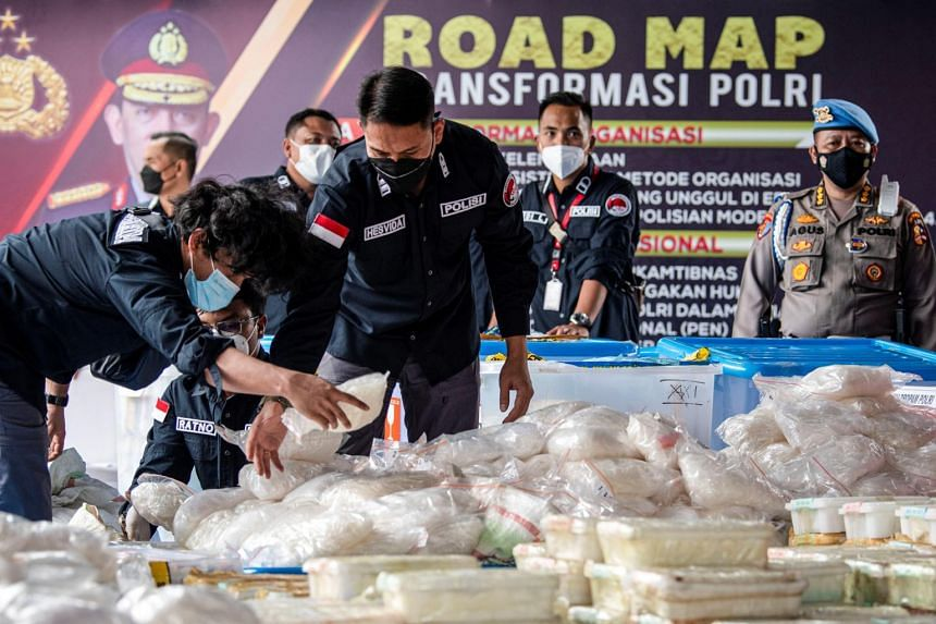 In this photo taken on April 28, 2021, Indonesian police officers arrange 2.5 tonnes of seized crystal methamphetamine in Jakarta.