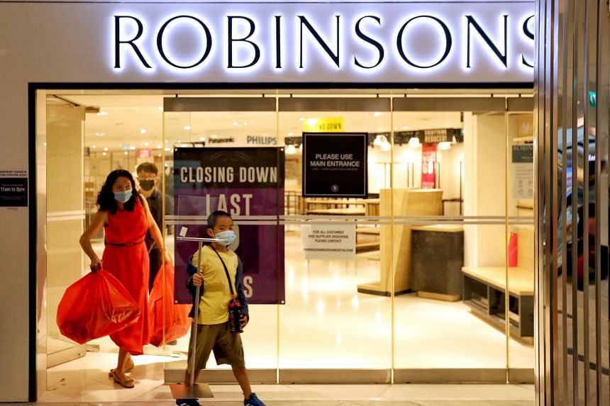 The last customers leaving the Raffles City outlet of Robinsons, before its closure, on Jan 9, 2021.