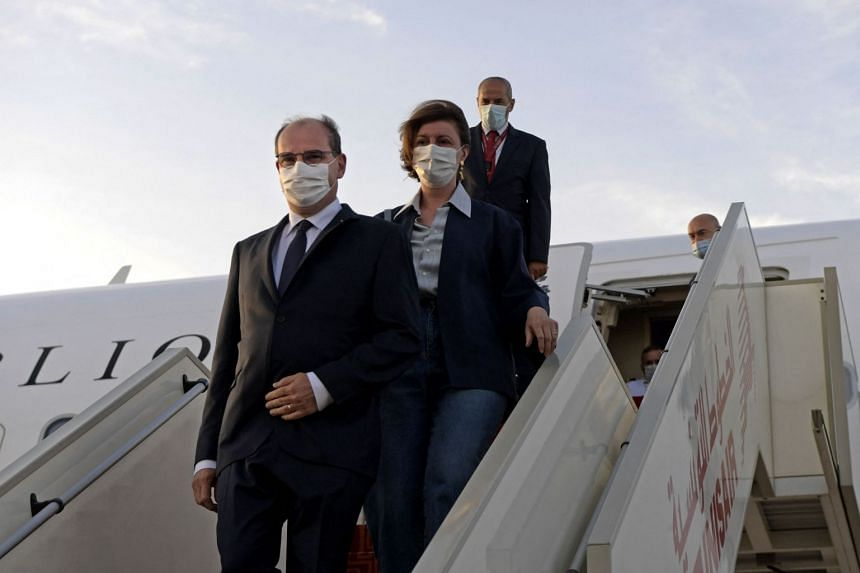 A June 2, 2021, photo shows French Prime Minister Jean Castex and his wife arriving for a visit to Tunisia.