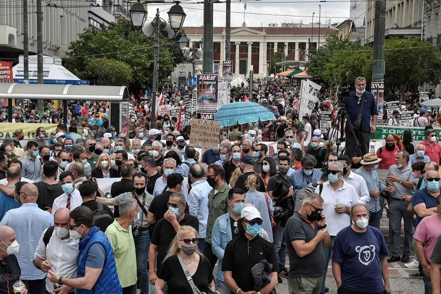People taking part in a demonstration in Athens on June 10, 2021.
