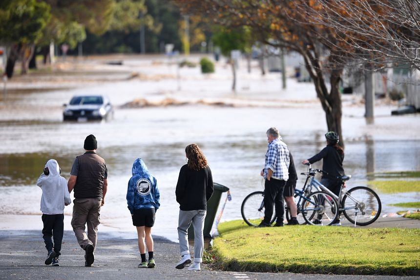 People observe the flood water in Traralgon, Australia, on June 10, 2021.