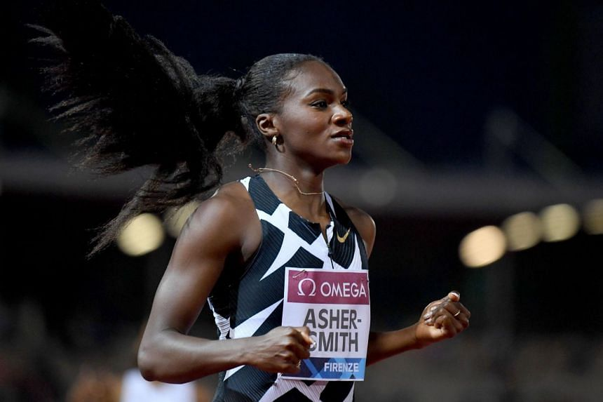 Dina Asher-Smith reacts after winning the women's 200m.