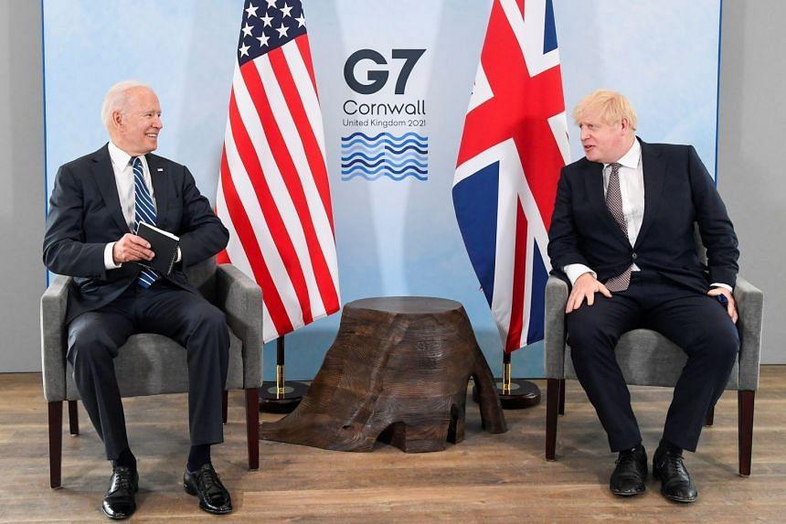 Boris Johnson speaks to Joe Biden during their meeting ahead of the G7 summit, in Carbis Bay, Cornwall.