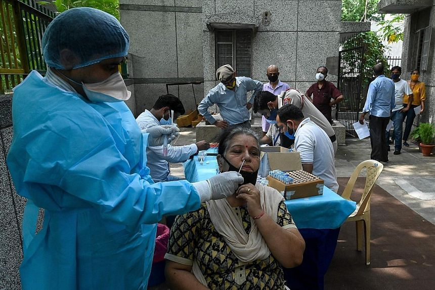 A woman being tested for Covid-19 in New Delhi yesterday. Concerns over the under-reporting of deaths in India were heightened during the recent second wave.